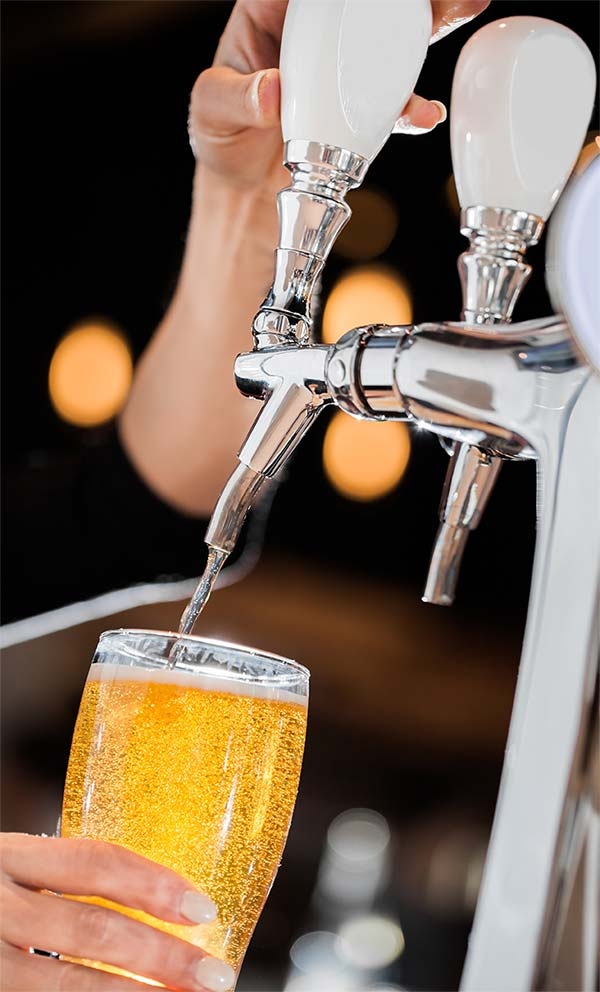Pouring Draft Beer Out of a Kegerator