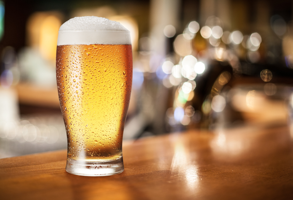 glass of ordinary bitter beer on bar counter
