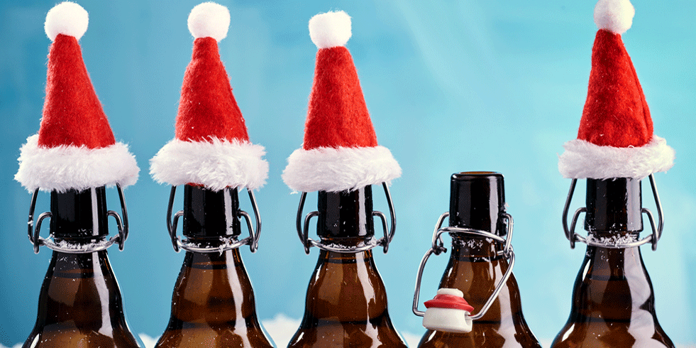 Beer bottles wearing Santa hats